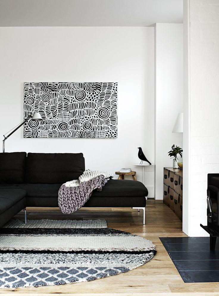 """Carole paired the simple modernist lines of the sofa with a heavily textured wool rug by Patricia Urquiola for [Gan Rugs](http://www.gan-rugs.com/?utm_campaign=supplier/ target=""""_blank"""")."""