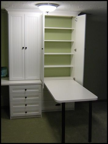 This would be genius for the craft closet! Hide away table- there when you need it, gone when you don't, AND with more storage shelves behind the table, all concealed in a nice neat cabinet!