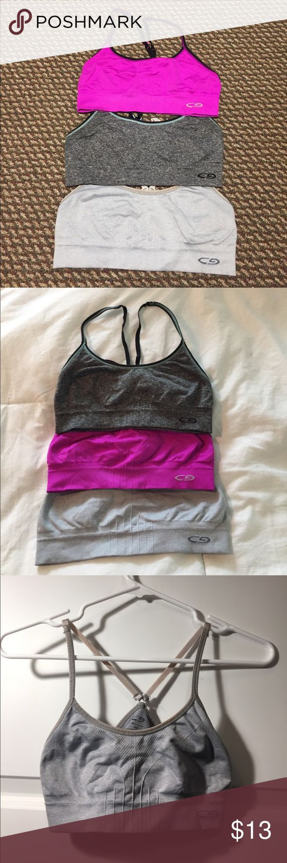 BUNDLE 3 Champion Sports Bras Bundle of three Champion C9 Seamless Cami sports bras, retailing for $17 EACH but only $13 for all three of these! All in size XS, in magenta, light gray, and charcoal gray. The light gray sports bra's straps are tinted slightly pink due to a laundry mishap but other than that they are in great condition. The last photo shows a model wearing the same bra in a different color. Offers are welcome and feel free to leave any questions below. Champion Intimates…
