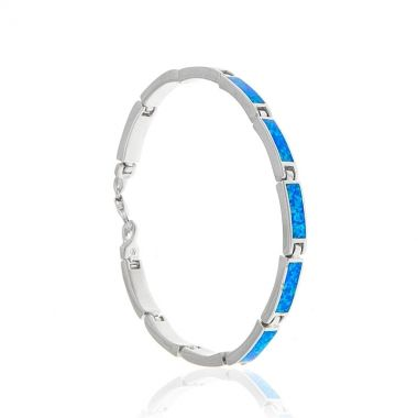 This sterling silver link bracelet features eleven rectangular blue opal stones. The highly polished sterling silver and the dazzling colour of the blue opal, create an amazing piece of silver jewellery bound to attract attention. Just like the endless blue colour of the Greek sea, the blue opal stone will add a colourful flair to any outfit. Match it with a blue opal sterling silver necklace and get ready to be showered with compliments.
