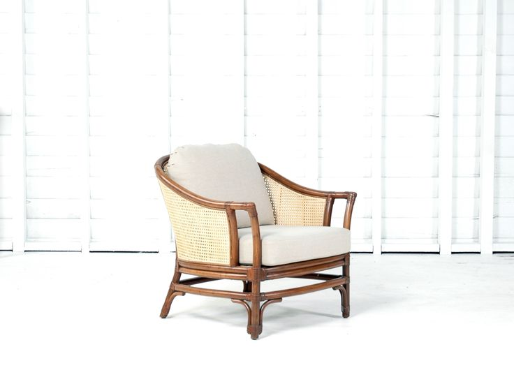 The lines of the Java Lounge Chair define the classic lounge chair shape. Tightly woven 'basket weave' cane wraps around a rich pecan rattan frame, ensuring a comfortable sit. The timeless combination of caning paired with rattan poles makes for a beautiful statement chair.