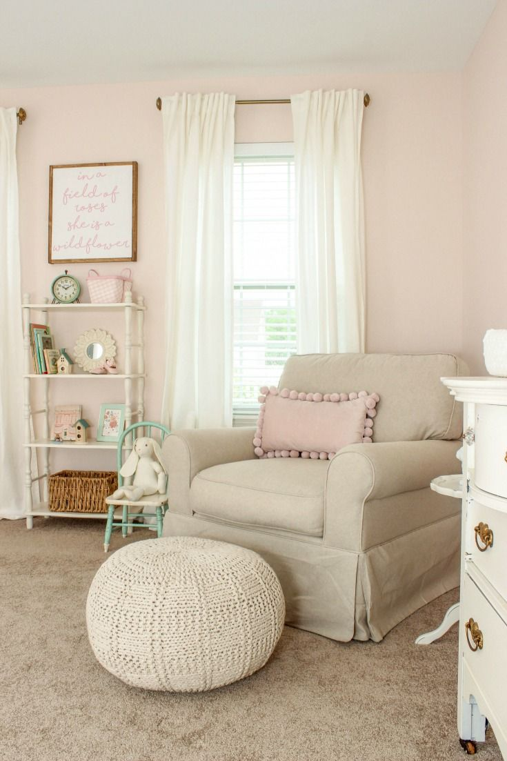 Tour a sweet blush pink nursery with touches of vintage decor