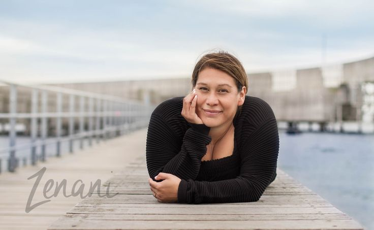 Portrait of woman on the beach, business portrait on location
