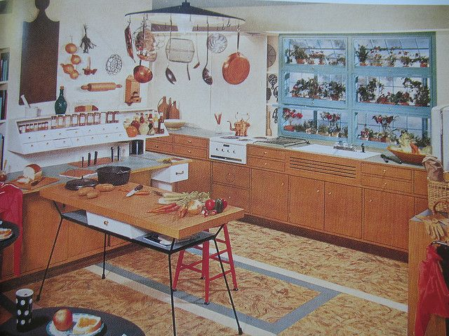 Curious 1950s Kitchen by Library Fashionista, via Flickr That table.