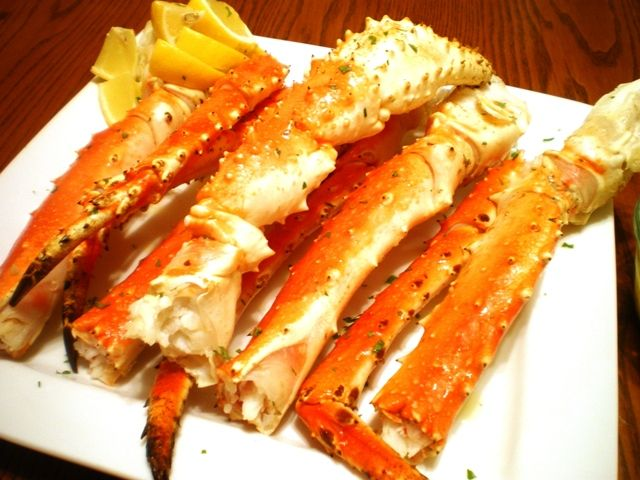 Baked King Crab Legs with Garlic Lemon Butter Sauce Recipe - Great Deals at www.AlaskaKingCrabs.com