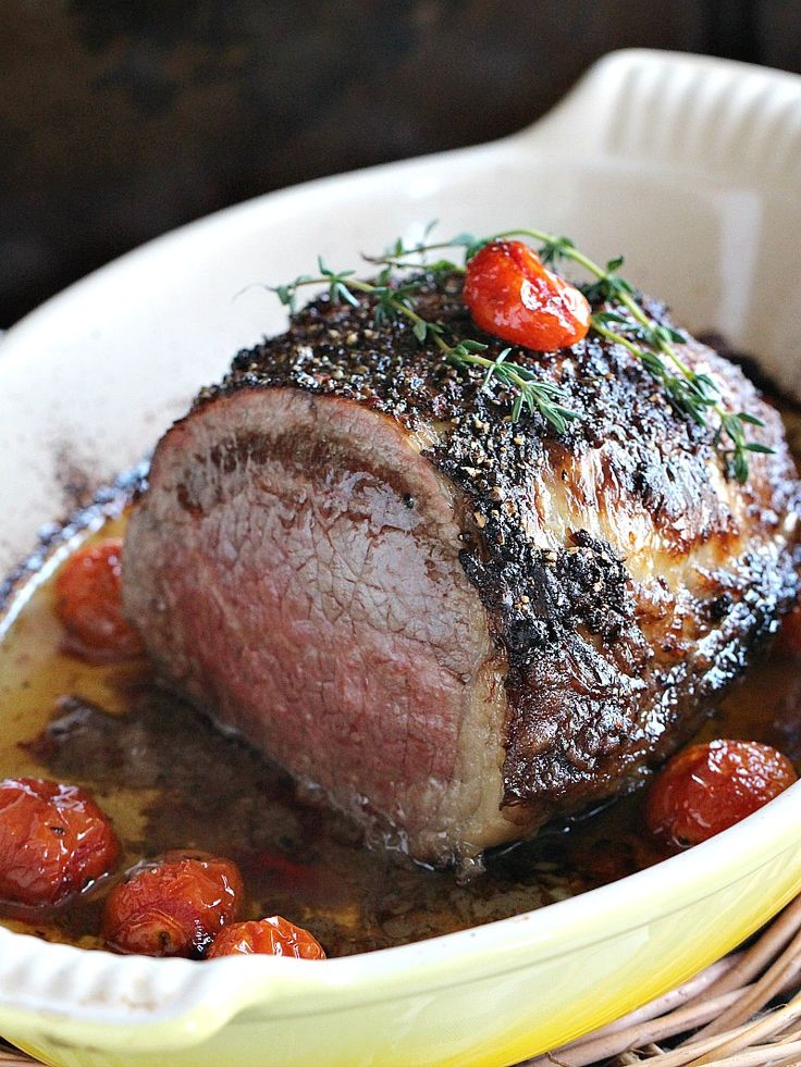 Garlic and Wine Roasted Beef Tenderloin with a peppery crust, served with juicy roasted tomatoes.