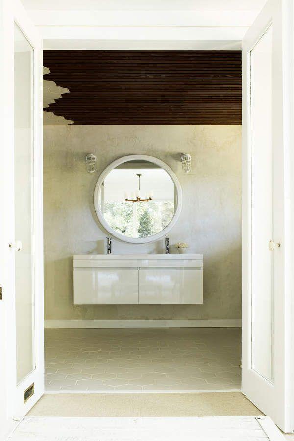 white floating bathroom cabinet, white hexagon tile floor