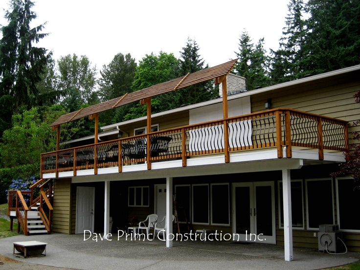 Solid deck w cedar rail and decorative metal balusters dave primc