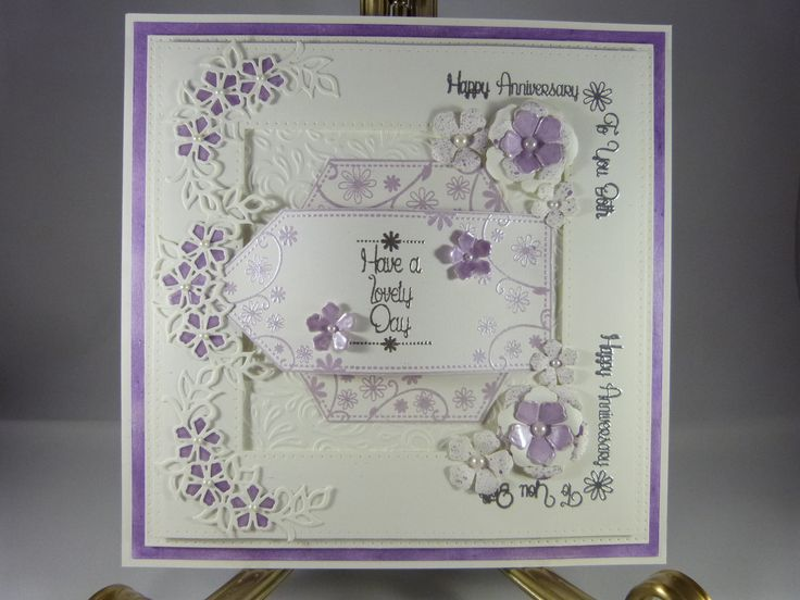 8x8 card using the daisy stamps in coconut white and mauve