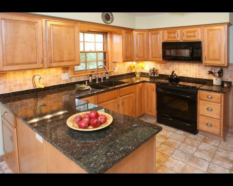 Dark Granite Countertops With Light Wood Cabinets Create A Balanced Look.  Great Idea For A Small Kitchen Design. Part 53