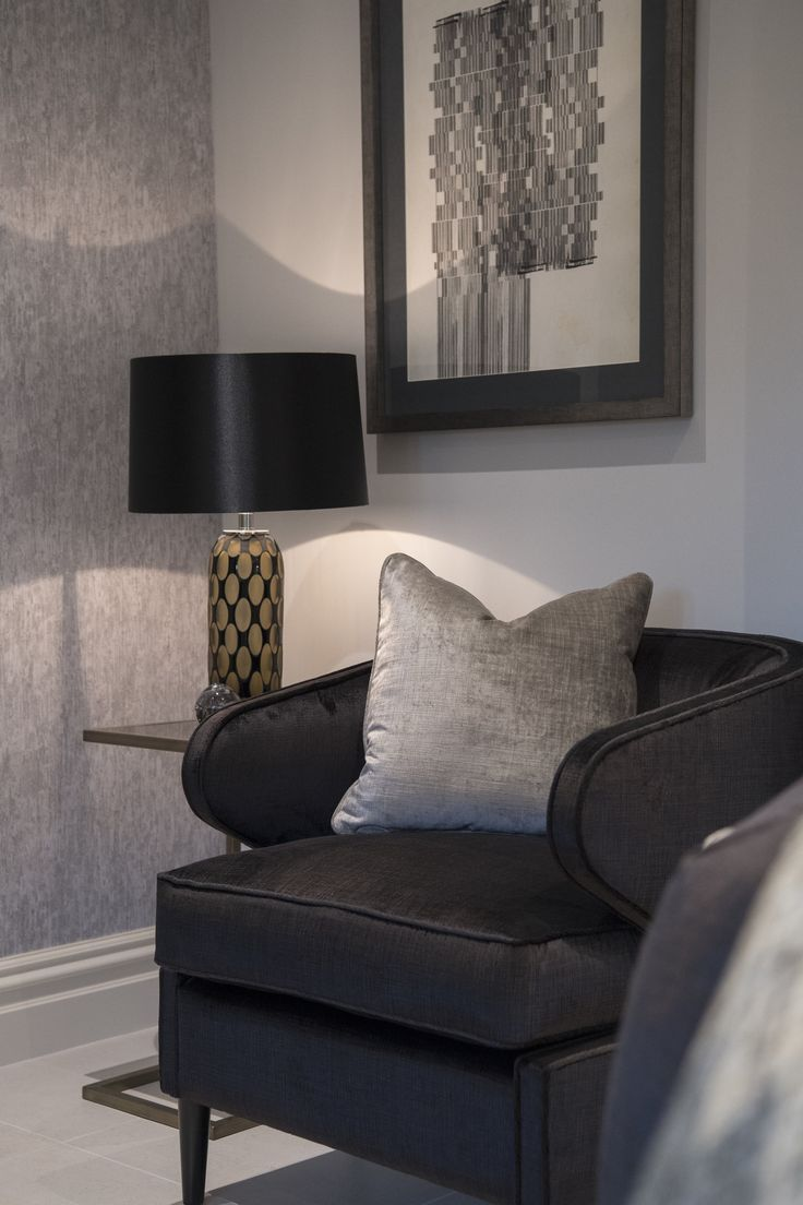 A stunning statement piece, this lustrous armchair in dark, mesh-effect velvet contrasts with the light grey hue of the room; accented by the silver cushion, bringing another layer of elegance and grace to the design. #interiordesign #luxurylife #luxury #london #luxuryproperty #luxuryhomes #londonproperty #luxuryinteriors