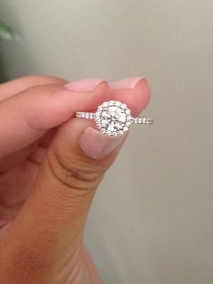 I'm so in love. Ritani engagement ring, round center diamond, french set with a halo. by Angelic Harmony
