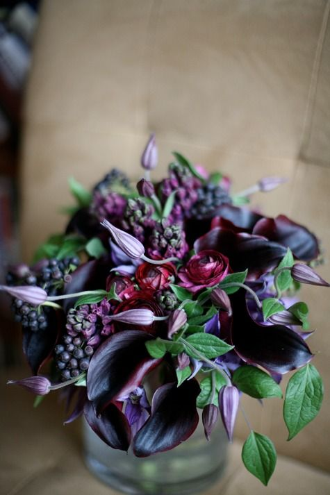 bouquet from bulb flowers like hyacinth and ranunculus along with the calla lilies and clematis vine- love the colors