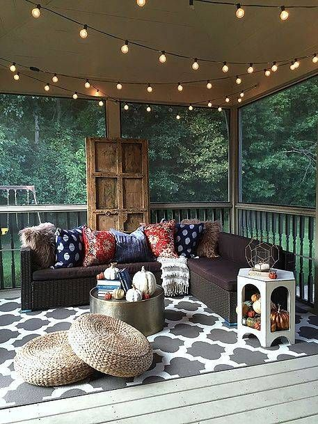 screened-in porch with string lights