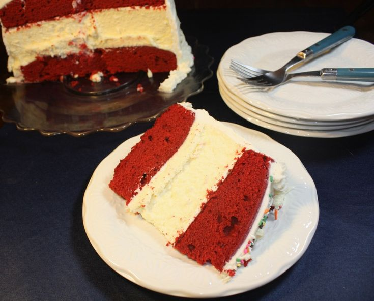 Decadent three layer cake! Red Velvet and Cheesecake Celebration Cake. If you like the Cheesecake Factory's cake, you'll love this recipe - The Foodie Affair #cake #cheesecake #redvelvet