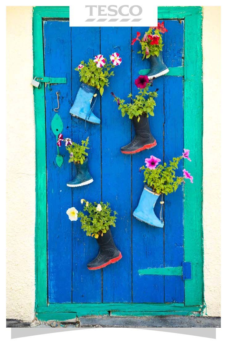 Add some personality to your garden with a wall of recycled wellies transformed into pretty planters. It's a great way to get kids excited about the garden, too. | Tesco Living
