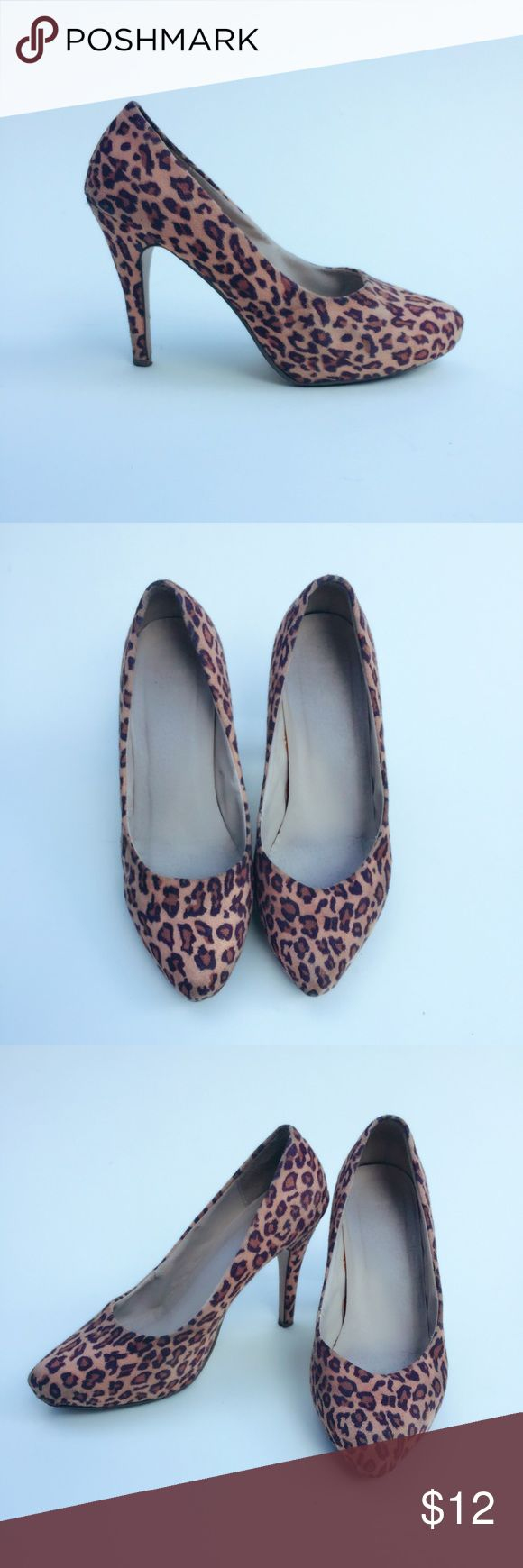 Leopard printed heels Super sassy and cute leopard heels! Comfortable and doesn't cut into your feet because of soft material! Clean insole with no footprints, normal wear and tear at bottom of heels but actual heel support still intact just scuffs on bottom from walking. Heel height: 4.5 inches Shoes Heels