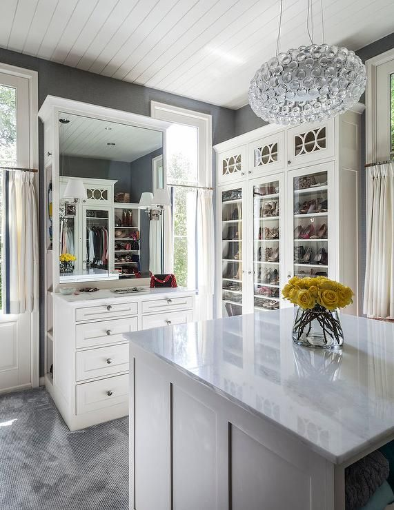 White And Gray Closet Features Gray Walls Lined With Glass