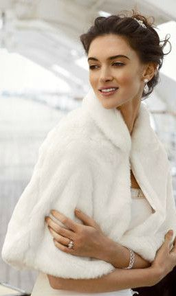 Ward off the winter chill with this plush and stylish faux fur caplet, available in both Ivory and White! David's Bridal Style WC603140