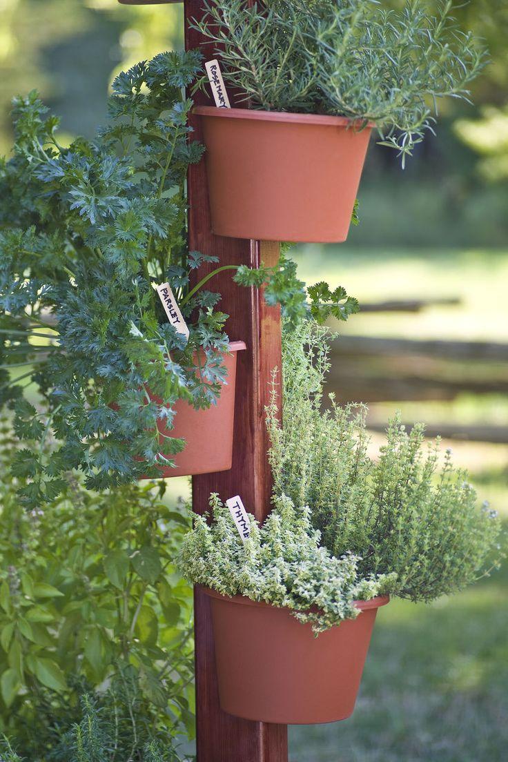 25 best ideas about flower pot tower on pinterest for Vertical garden tower