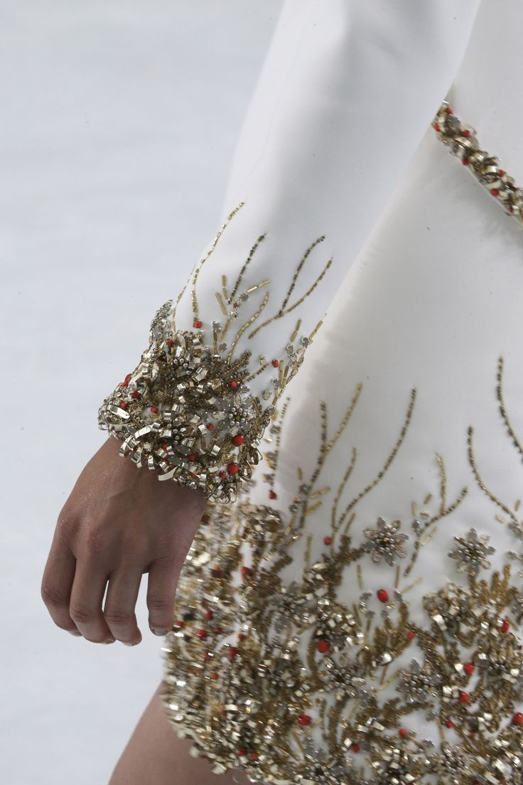 Vogue UK. Chanel's catwalk. Haute couture A/W 2014-15. Lots of embroidery details in monocromatic pieces