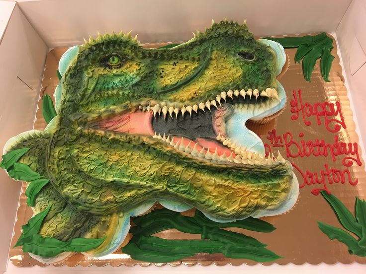 Dinosaur pull apart cupcake cake done with 26 cupcakes and buttercream icing