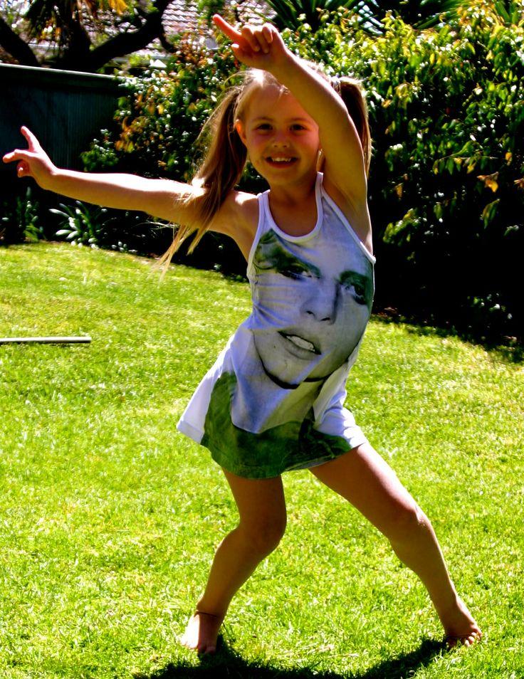 Little miss Lady Ga Ga loving her dress, check it out ....www.4angels.com.au