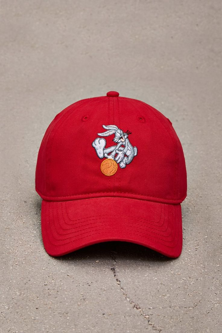 A woven baseball cap featuring an embroidered image of Bugs Bunny playing basketball and an adjustable back strap.<p>- Officially licensed product</p>