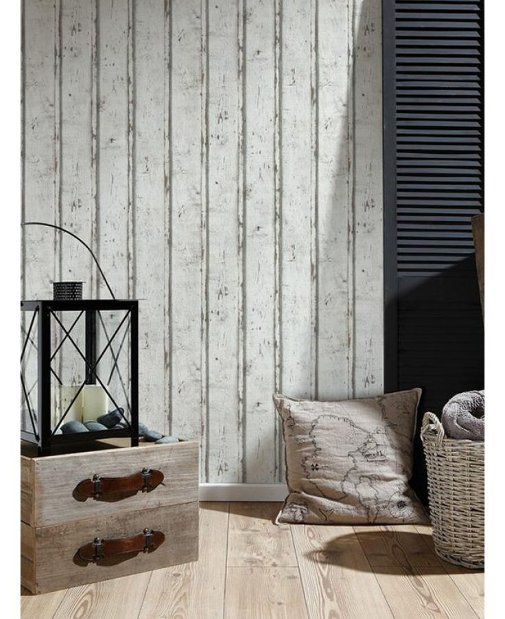 This stylish Wood Planks Wallpaper would make a great feature in any room. The design features distressed look whitewashed wooden panels, with natural tones of brown and grey showing through to add to the rustic feel and a textured wood grain effect finish