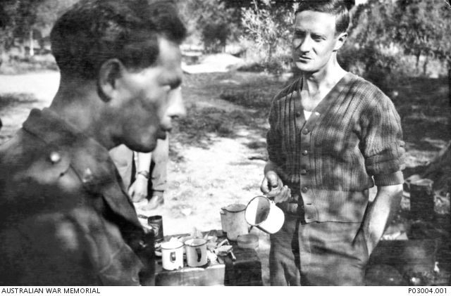Crete. April 1941. Damien Parer (left) and Ron Williams stopped for a tea break on 42nd Street in Suda Bay. (Donor N. McDonald)