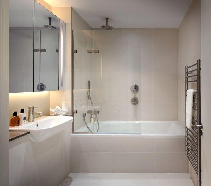 half glass shower door on tub