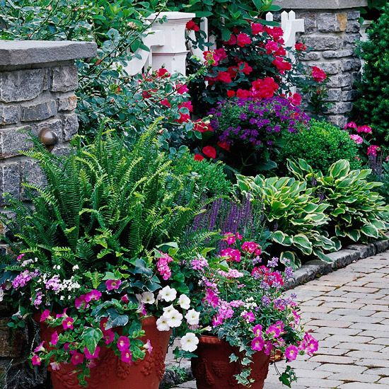 Floral Profusion - Garden borders include romantic roses, soothing hosta foliage, and cheerful container combinations lend charm to the intimate setting of the dining room terrace.