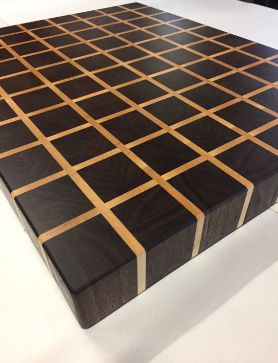 This here is a end grain cutting board made in a checker board pattern. Entire cutting surface is 100% end grain including grout joints. Woods used are Black Walnut and Hard Maple.  Board measures 16 inches wide 20 inches long and 2 inches thick. At these dimensions the board weighs just over 16 pounds. End grain cutting boards are very durable and are engineered for many years of use. End grain is better for knives staying sharp much longer than long grain wood cutting boards.  Recessed…
