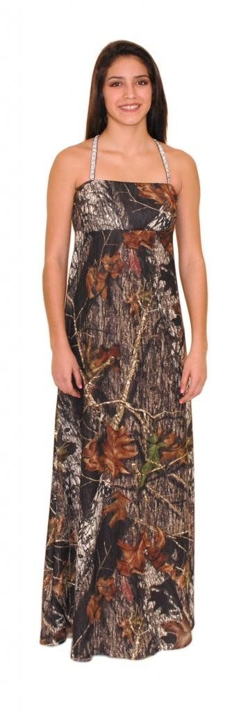Camo Diva Mikayla Camo Sequins Strap Prom Gown 3X Camouflage. Sequins straps that cross in the back of this exquisite camo dress. Flared from the waist down, this camo prom dress is approximately 45 inches from under the bust to hem. The stunning sequins and elegance of the soft silky Mossy Oak Patterned Poly-Spandex blend material makes this a must have for any camo prom or camo wedding. This camo gown is fitted for most Junior thru Plus Size Women. Made in the USA, Mossy Oak Licensed...