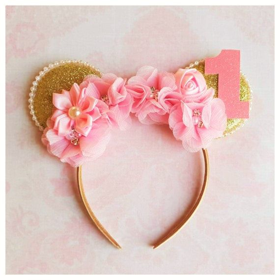 ~~ Pink and gold Minnie mouse ears headband ~~  These Adorable Minnie Mouse Ears would be the perfect addition to any of our birthday outfits, Disney Vacation, or every day wear.  They are in gold glitter color embellished with pink chiffon flowers, rosettes and number 1 - we can always make them with any other age number, just contact us with details.  Please note: Top quality materials are used to make all our designs.   Design will be exactly as pictured.  Please feel free to contact me…