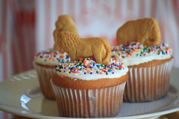 Zoo party, circus party, jungle party. Animal crackers in cupcakes.  So easy!