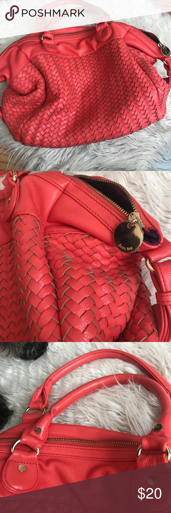 Coral/Orange Shoulder Bag Coral/Orange Basket weave Shoulder Bag. Bright purple interior. Used several times but in good condition. There are marks on the inside of the bag. One small peel on the bottom of the bag. Really great size and a beautiful orange Fall color. Deux Lux Bags