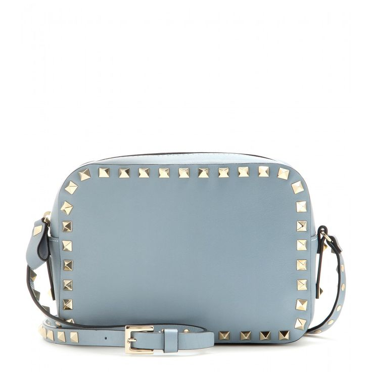 Valentino - Rockstud leather cross-body bag - Downsize your tote to this practical shoulder bag from Valentino. Pastel blue-hued leather finished with the label's iconic 'Rockstud' hardware is a modern and edgy fusion. Wear it over the shoulder or across your body next to bright colours or monochrome ensembles. seen @ www.mytheresa.com