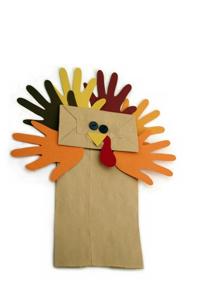 thanksgiving handprint turkey puppet Thanksgiving turkey DYI craft for kids.