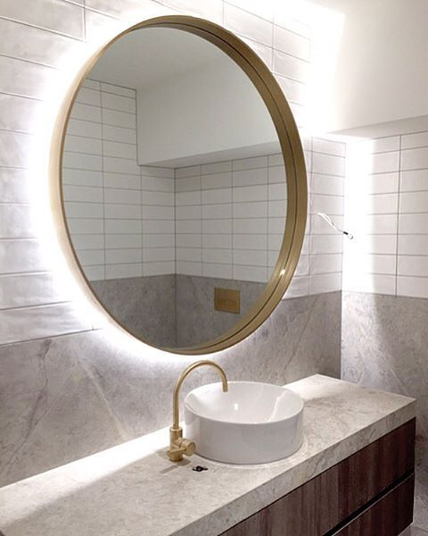 A halo of light around this custom brass mirror at our almost complete project. Happy Friyay everyone! #mimdesign #mimdesignresidential #melbournedesigner @hamiltonmarinobuilders @cdkstone