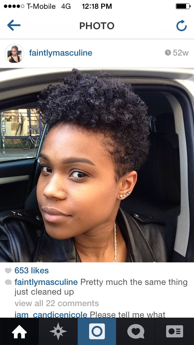 Low sides, longer top tapered pixie haircut. Natural hair. Faintly masculine