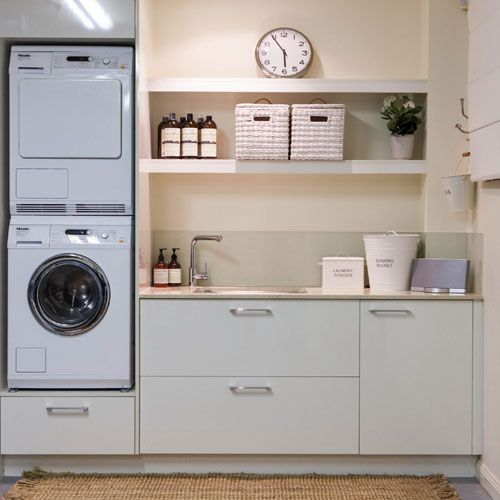 Stacked machines, great sink and storage space.  Like the idea of a raised machines easier for unloading washing