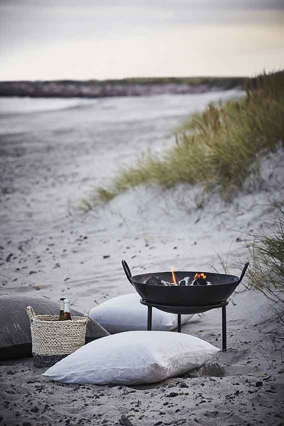 Comfy pillows and a warm fire on a beach would be a must.