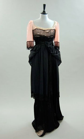 Black crepe dress ca.1912. This has been heavily restored. Among the changes were a new pink inner bodice. Still, it looks like something Audrey Hepburn would wear.