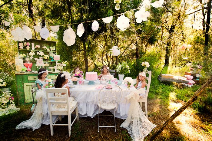 I love everything about this little party. The jewels on the cupcakes, the fancy little dresses. How perfect!