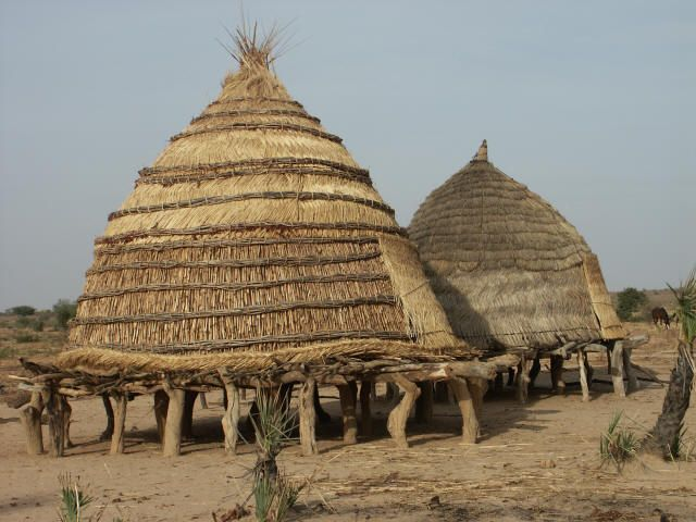 Africa | Traditional granaries.  southern Niger | ©Peter Stong