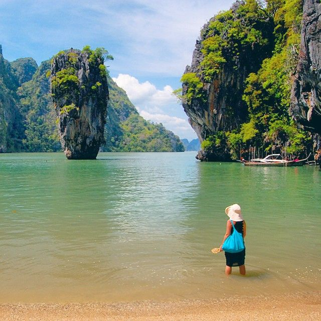 Liz...Thailand....On the beach of the KhaoPhingKan island in Thailand. The 20-metre tall islet raising from the sea some 40 metres from the shore is called KoTapu, commonly called the JamesBondIsland since 1974, when it was featured in a JamesBond film. ••• Photo by @travelplusstyle. More: http://www.travelplusstyle.com.Thailand