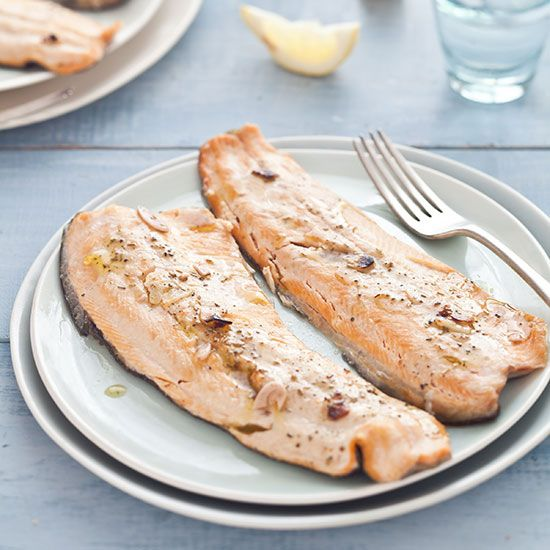 Tuscan Grilled Trout | A simple garlic-and-herb-infused oil combined with wine vinegar acts as both a basting liquid and a sauce for the fish. The trout skin protects the flesh and turns an appealing golden brown during grilling.
