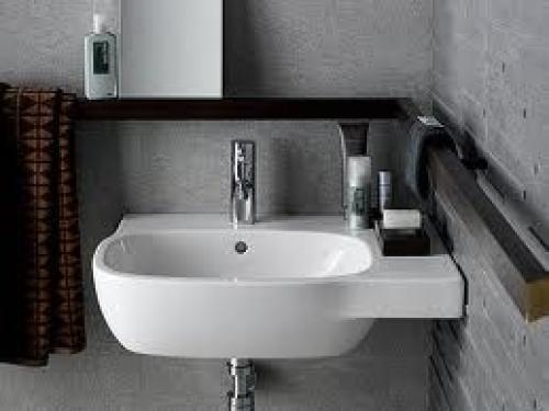 Asszimetrikus mosdó 60 x 46 csaplyukkal, túlfolyóval Rendelhető jobbos és balos kivitelbe! A csaptelep és a szifontakaró nem tartozék!