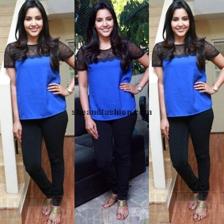 Priya Anand in high neck top and jeans